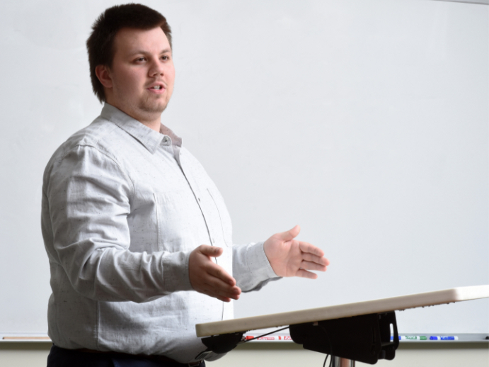 Business school student presenting in classroom